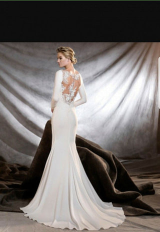 This simply elegant style is straight out of a at Spotlight Formal Wear! #SpotlightBridal