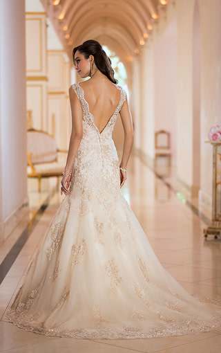 Check out the elegant back on this stunning gown! Available at Spotlight Formal Wear!…